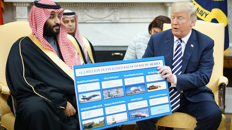 US President Donald Trump (R) holds a defence sales chart with Saudi Arabia's Crown Prince Mohammed bin Salman, March 20, 2018 in Washington, DC. Mandel Ngan