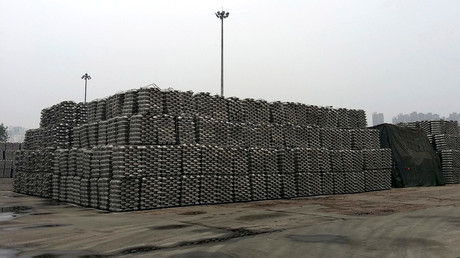 FILE PHOTO: Aluminum ingots are piled up at a bonded storage area at the Dagang Terminal of Qingdao Port, China © Fayen Wong
