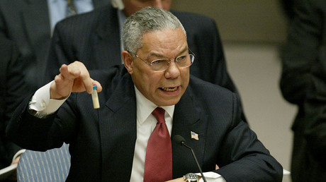 Colin Powell holds up a vial that he described as one that could contain anthrax, during his presentation on Iraq to the U.N. Security Council, Feb. 5, 2003. © Ray Stubblebine