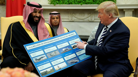 US President Donald Trump holds a chart of military hardware sales as he welcomes Saudi Arabia's Crown Prince Mohammed bin Salman, March 20, 2018 / Jonathan Ernst