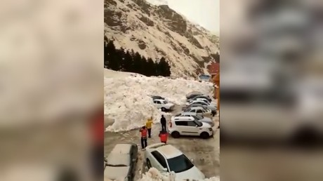 Avalanche buries cars in parking lot after roaring down Russia's Mt Elbrus (VIDEO)
