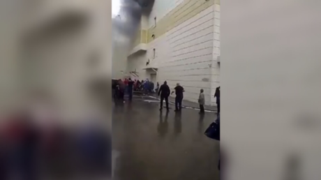 Dramatic VIDEO shows man jumping out of burning shopping mall in Russia
