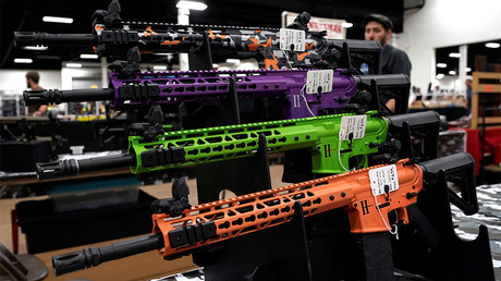 AR-15 rifles with colored hand guards © Joshua Roberts