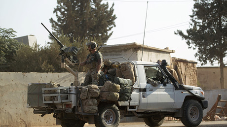 U.S soldiers ride a military vehicle in al-Kherbeh village, northern Aleppo province, Syria October 24, 2016. ©Khalil Ashawi