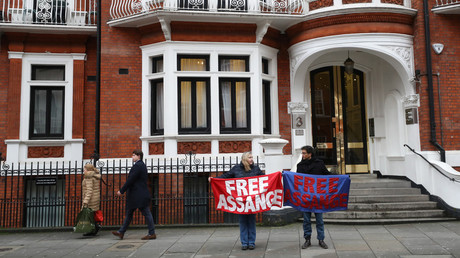 Assange supporters hold a banner outside the Ecuadorian Embassy in London, Britain, February 13, 2018. © Peter Nicholls