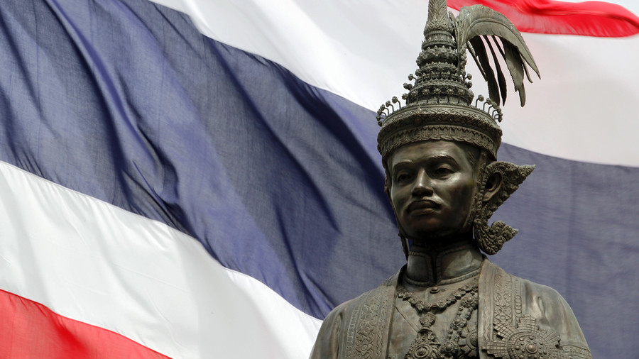 'Blasphemous act': Editor faces 15yrs in jail after posting masked image of Thai kings online