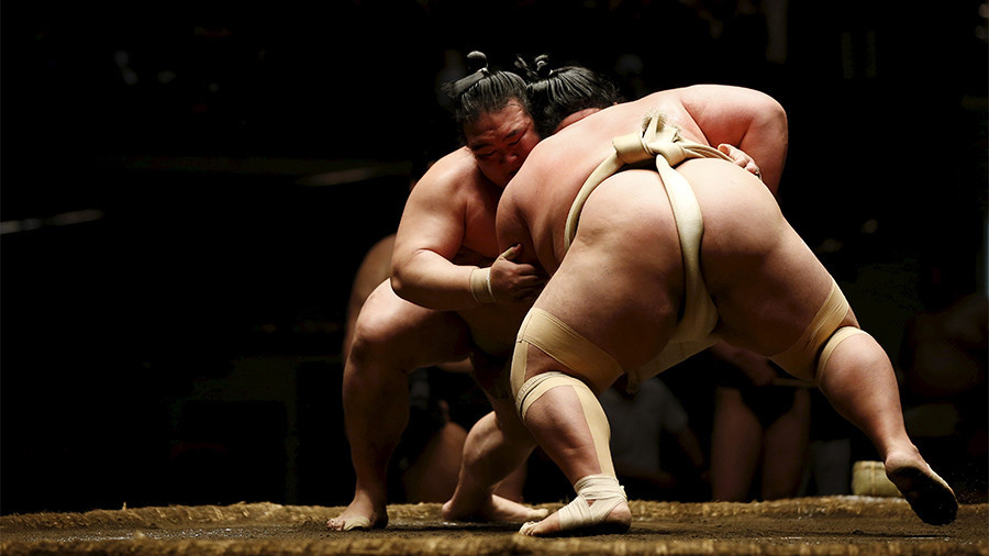Sumo stokes controversy as 'ritually unclean' female medics banished from 'sacred' ring