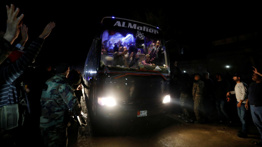 Thousands of Jaysh al-Islam militants leave Syria's Douma, release POWs