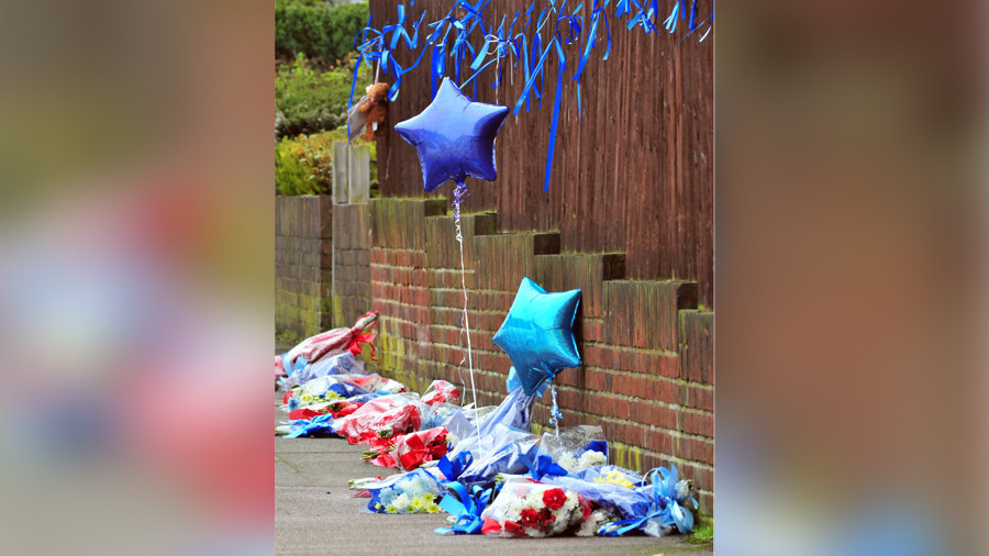 Shrine to murdered burglar torn down by 'furious' vigilante outside home where he was killed
