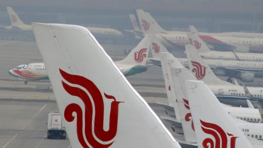 Air China plane diverts after fountain pen hostage drama class=
