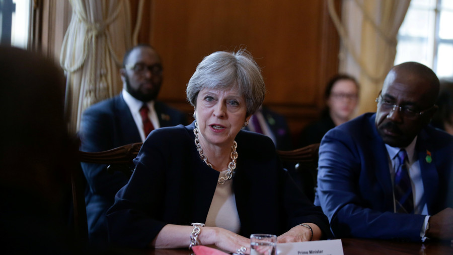 Theresa May apologises to Caribbean leaders over Windrush controversy