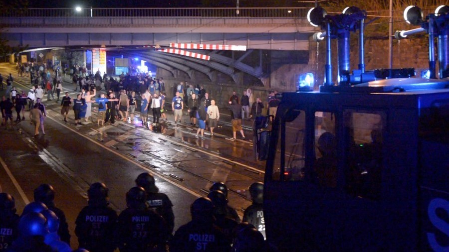German police deploy water cannon as football fans' celebrations descend into chaos (VIDEO)