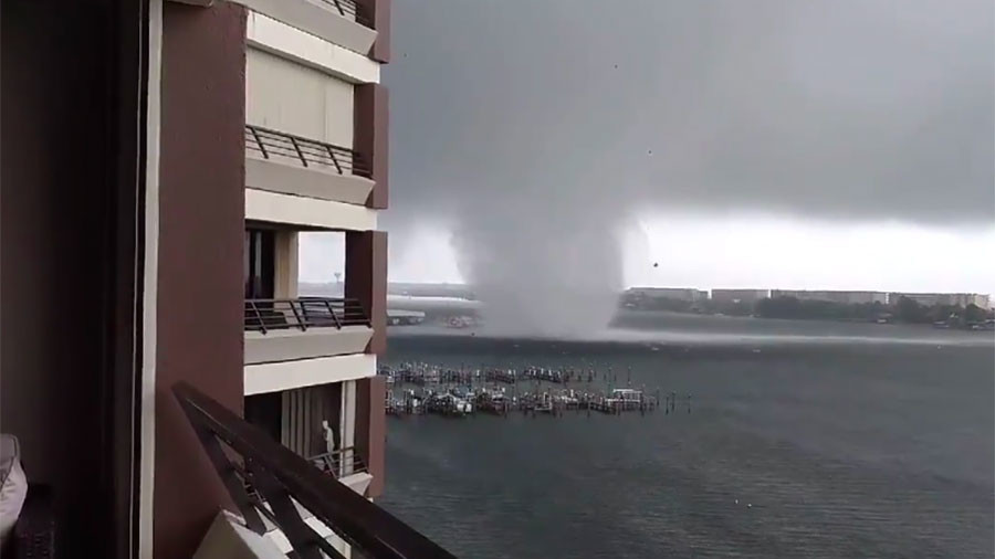 Stomach-churning moment tornado rips into Florida bay caught on camera (VIDEOS)