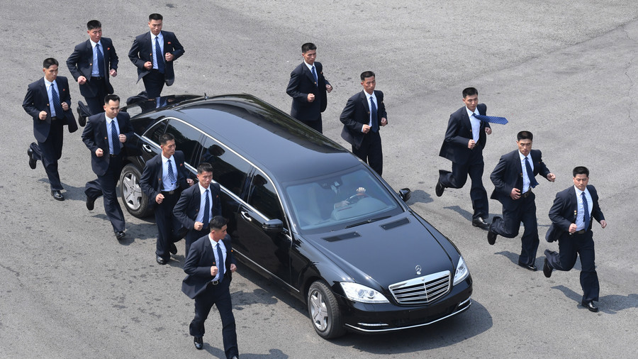 kim jong un 39 s men in black jog outside his car as the leader heads for lunch video rt. Black Bedroom Furniture Sets. Home Design Ideas