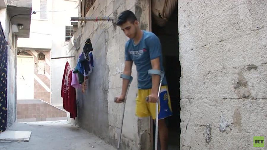 'I didn't think my leg would be like this': Gazan who lost limb in IDF sniper fire talks to RT
