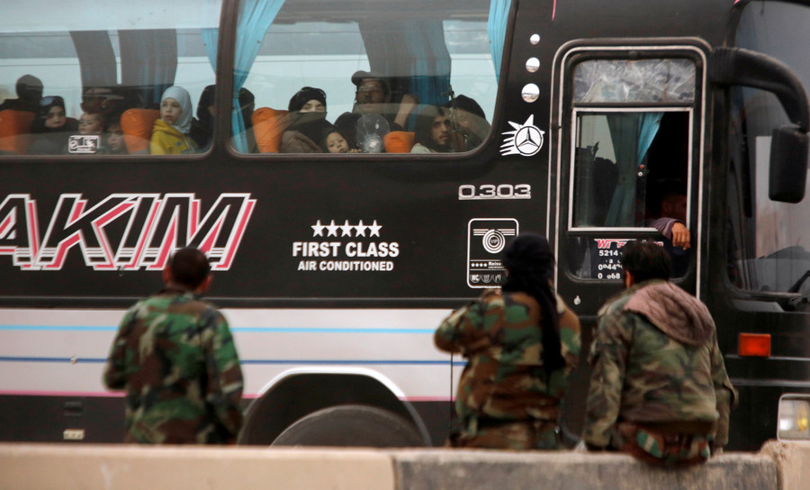Buses arrive for militants withdrawing from Syria's Douma