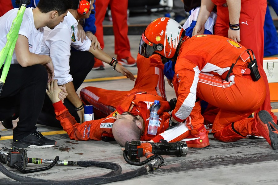 Ferrari F1 mechanic breaks leg in grisly pit stop accident (GRAPHIC VIDEO)