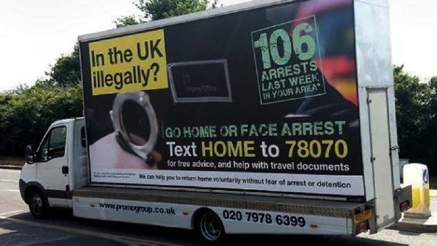 'Go home or face arrest' vans approved while she was on holiday – May's former special adviser