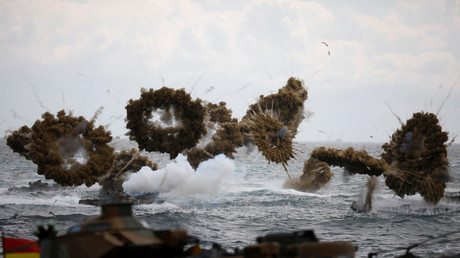 FILE PHOTO: Amphibious assault vehicles of the South Korean Marine Corps fire smoke bombs during a U.S.-South Korea joint Foal Eagle drill in 2017 ©