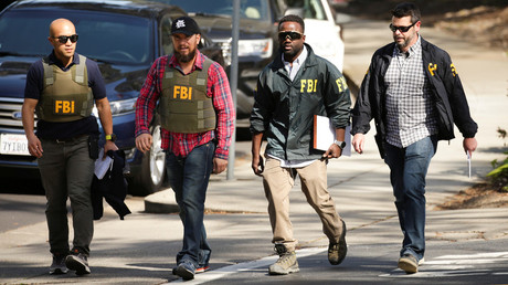 FBI agents near the YouTube headquarters in San Bruno, California, April 3, 2018. © Elijah Nouvelage