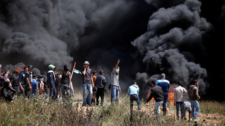 FILE PHOTO: Palestinian demonstrators gather at the Israel-Gaza border during clashes with Israeli troops east of Gaza City, on April 6, 2018. © Mohammed Salem