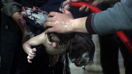 A photo showing a child being washed after what the White Helmets and other anti-government groups in Syria claim was a chemical weapons attack in Douma, Eastern Ghouta, on April 7. The Russian military says the photos were staged. © Reuters
