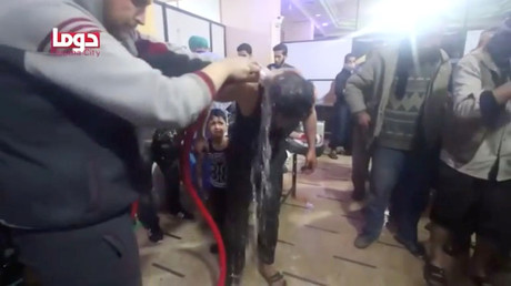 A man is washed following alleged chemical weapons attack, in what is said to be Douma, Syria in this still image from video obtained by Reuters on April 8, 2018 © White Helmets