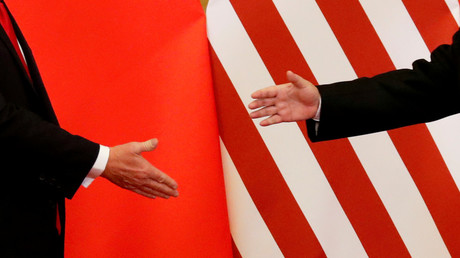 FILE PHOTO: U.S. President Donald Trump and China's President Xi Jinping shake hands after making joint statements at the Great Hall of the People in Beijing, China, November 9, 2017 © Damir Sagolj