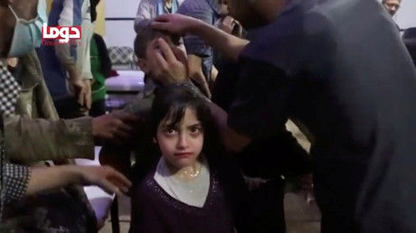 A girl looks on following alleged chemical weapons attack, in what is said to be Douma, Syria in this still image from video obtained by Reuters on April 8, 2018. © White Helmets /
