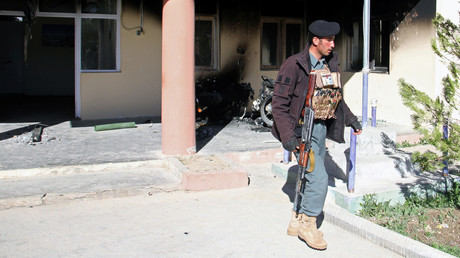 An Afghan policeman walks at the government district building after a Taliban attack in Khawaja Omari district of Ghazni province, Afghanistan April 12, 2018. ©