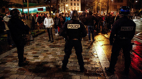 French police stand in front of students from the Tolbiac campus, part of the prestigious Sorbonne University in Paris on April 12, 2018. © AFP