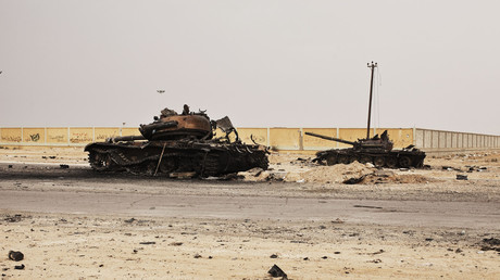 FILE PHOTO. Libyan government tanks destroyed by Western air strikes in 2011. © Finbarr O'Reilly
