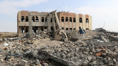 A man is seen at the site of an airstrike that destroyed the Community College in Saada, Yemen April 12, 2018. © Naif Rahma