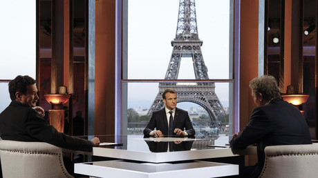 French President Emmanuel Macron (C) poses on the TV set before an interview with RMC-BFM journalist Jean-Jacques Bourdin (R) and Mediapart investigative website journalist Edwy Plenel (L), at the Theatre National de Chaillot  in Paris, France, April 15, 2018, Francois Guillot