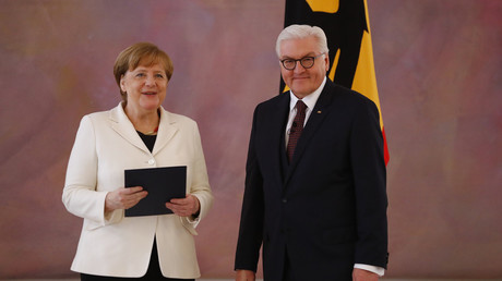 File photo: German Chancellor Angela Merkel receives her certificate of appointment from President Frank-Walter Steinmeier after being re-elected as chancellor, during a ceremony at Bellevue Palace in Berlin, Germany, March 14, 2018. Fabrizio Bensch
