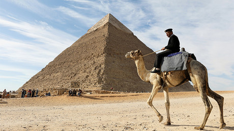 A police officer patrols the Giza Pyramids on his camel on the outskirts of Cairo © Mohamed Abd El Ghany