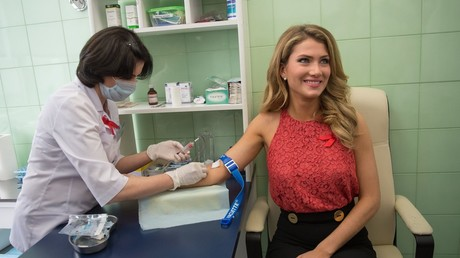 Miss World 2015 Mireia Lalaguna doing a HIV test in support of the Joint United Nations Programme on HIV / AIDS 90-90-90 initiative at the Center for Molecular Diagnosis of Rospotrebnadzor's Central Research Institute of Epidemiology © Evgenya Novozhenina