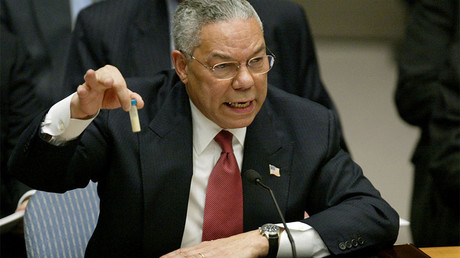 FILE PHOTO: U.S. Secretary of State Colin Powell holds up a vial that he described as one that could contain anthrax © Ray Stubblebine