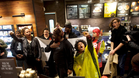 Protestors demonstrate inside a Center City Starbucks, where two black men were arrested © Mark Makela