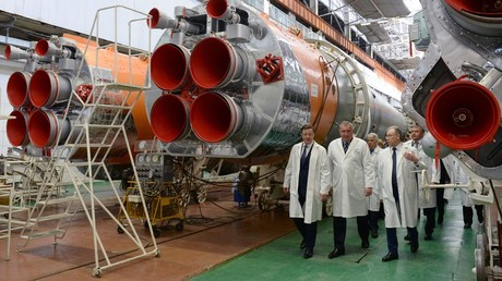 Acting Governor of the Samara Region Dmitry Azarov, Deputy Prime Minister Dmitry Rogozin and First Deputy General Director - General Designer - Head of the Progress Rocket Space Center Ravil Akhmetov, from left, durign a visit to the Progress Rocket Space Center © Sergey Mamontov
