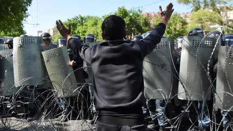 A demonstrator argues with riot police during a protest in Yerevan, Armenia April 16, 2018. © Vahram Baghdasaryan