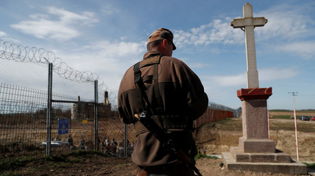 A Hungarian soldier stands at the Hungarian-Serbian border on April 3, 2018. © Bernadett Szabo