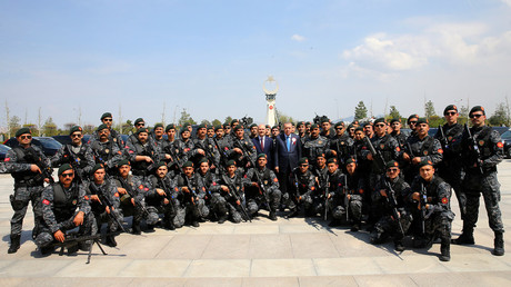 FILE PHOTO: President Erdogan poses with police officers © Kayhan Ozer