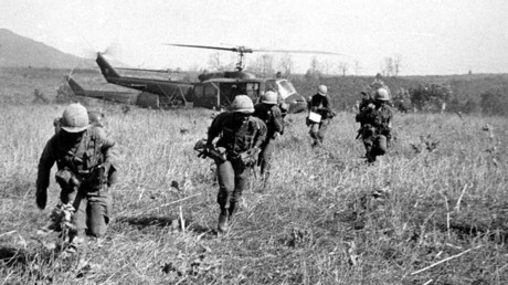 American soldiers get off helicopters during the operation