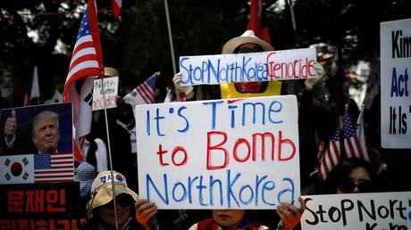 'Bomb North Korea' protest as leaders seek to defuse months of tension