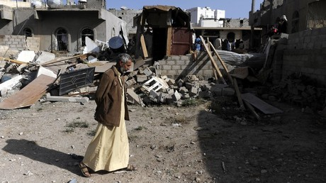 FILE PHOTO: A man walks near a house destroyed in a SAudi-led coalition airstrike in Sanaa, Yemen, on April 28, 2018. © Mohammed Mohammed