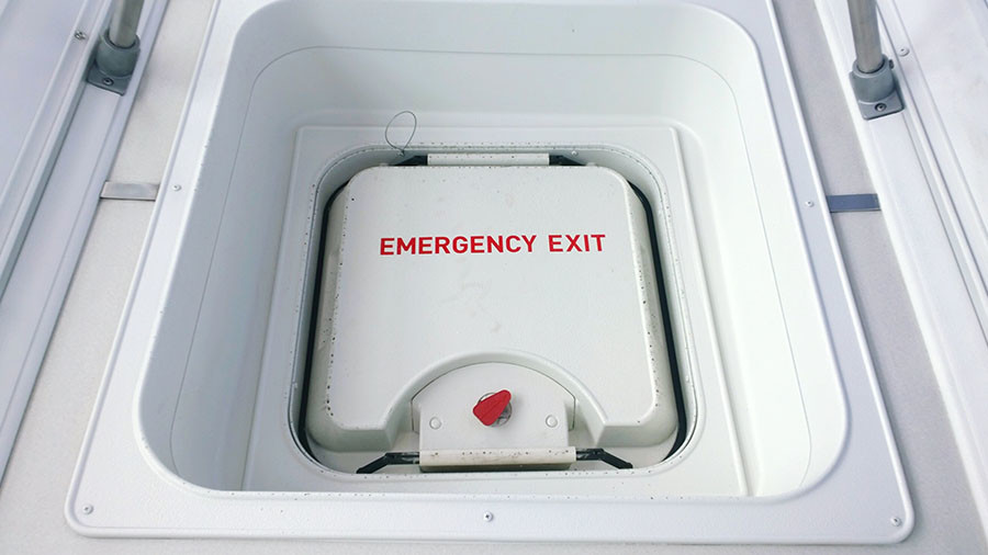 Flight passenger detained after he opens emergency exit to get fresh air
