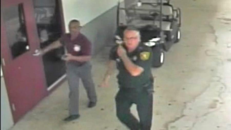 Father of Parkland school shooting victim sues 'coward' cop