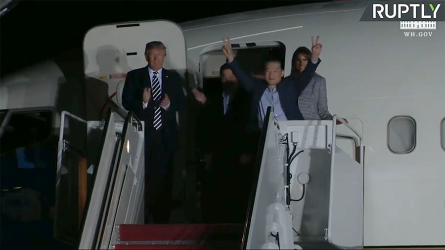 Americans released by North Korea land on US soil