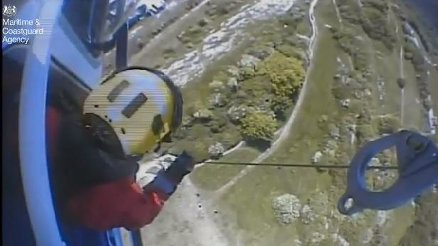 'Only minutes to spare': Teen clings to 300ft cliff face in heart-stopping rescue (VIDEO)
